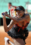 French Open 2010 23/05/10 D1.Venus Williams (USA) wearing one of her designs in first round match.Photo Anne Parker Fotosports International
