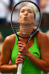 Jelena Jankovic of Serbia kisses her stings after winning the Ladies Title at the WTA and ATP BNP Paribas Open, Indian Wells, USA.Photo: Ella Ling..