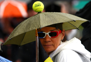Rain causes umbrellas to be put up at Roland Garros, Paris, 2010.Photo: Ella Ling.