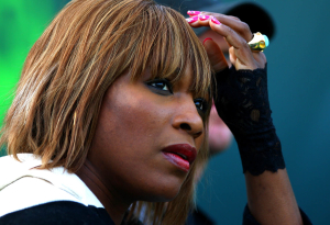 A blonde Serena Williams of USA watches her sister Venus in action at the WTA and ATP Sony Ericsson Open, Miami, USA.Photo: Ella Ling..