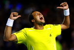 Jo-Wilfried Tsonga of France performs his victory dance at the Australian Open, 2010, Melbourne, Australia.Photo: Ella Ling..