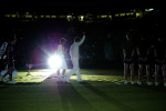 Rafael Nadal of Spain and Roger Federer of Switzerland walk off court in the dark following their Final at Wimbledon 2008.Photo: Ella Ling.