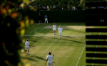 Doubles play on an outside court at Wimbledon.Photo: Ella Ling
