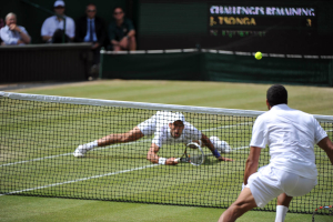 Wimbledon, 1/07/2011..Novak DJOKOVIC (SRB) defeats Jo-Wilfried TSONGA (FRA) 7-6(7/4) 6-2 6-7(9/11) 6-3 and becomes the World N.1 ranked player...Photo Ray Giubilo.....