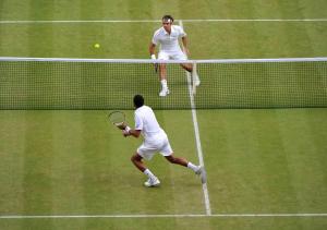 Wimbledon, 29/06/2011..Jo-Wilfried TSONGA (FRA) defeated Roger FEDERER (SUI) 3-6 6-7(7/3) 6-4 6-4 6-4..Photo Ray Giubilo.....