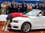 BMW Open 2011,250 ATP World Tour, Tennis Turnier, International Series,Iphitos Tennis Club, Sandplatz,Finale,Siegerehrung,Praesentation, Einzel,Sieger Nikolay Davydenko (RUS) legt sich auf die Kuehlerhaube von seinem gewonnenen Auto,lustig,Humor,