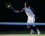 Wimbledon Championships 2011, AELTC,London,.ITF Grand Slam Tennis Tournament.Rasenturnier,.Gael Monfils (FRA),Einzelbild,Aktion,Ganzkoerper,.Querformat,Abendlicht,Stimmung,