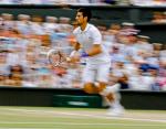 Wimbledon Championships 2011, AELTC,London,.ITF Grand Slam Tennis Tournament . Herren Finale,Endspiel, Novak Djokovic (SRB),Einzelbild,Aktion,Ganzkoerper,Querformat,Mitzieher,Zoomeffekt