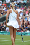 Wimbledon Championships Day 5 24/06/2011.Maria Sharapova (RUS) catches the breeze as she wins second round match.Photo: Roger Parker Fotosports International