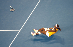 Melbourne Australian Open Tennis 2010 30/01/2010.Serena Williams (USA throws away her racket and falls to the floor as she wins Ladies Singles final.Photo:Roger Parker Fotosports International.