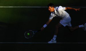 The Championships Wimbledon 25/06/2007.Tim Henman (GBR) comes to the net in the evening shadows during first round match.Photo Roger Parker Fotosports International.