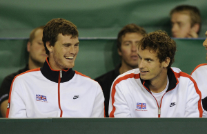 8/7/2010 DAVIS CUP TENNIS GLASGOW SCOTLAND GREAT BRITAIN V LUXEMBOURG PICTURE BY JAMIE AND ANDY MURRAY SHARE A JOKE AS THEY WATCH JAMES WARD PLAY IN 1ST MATCH AGAINST GILLES MULLER BY DAVE SHOPLAND .